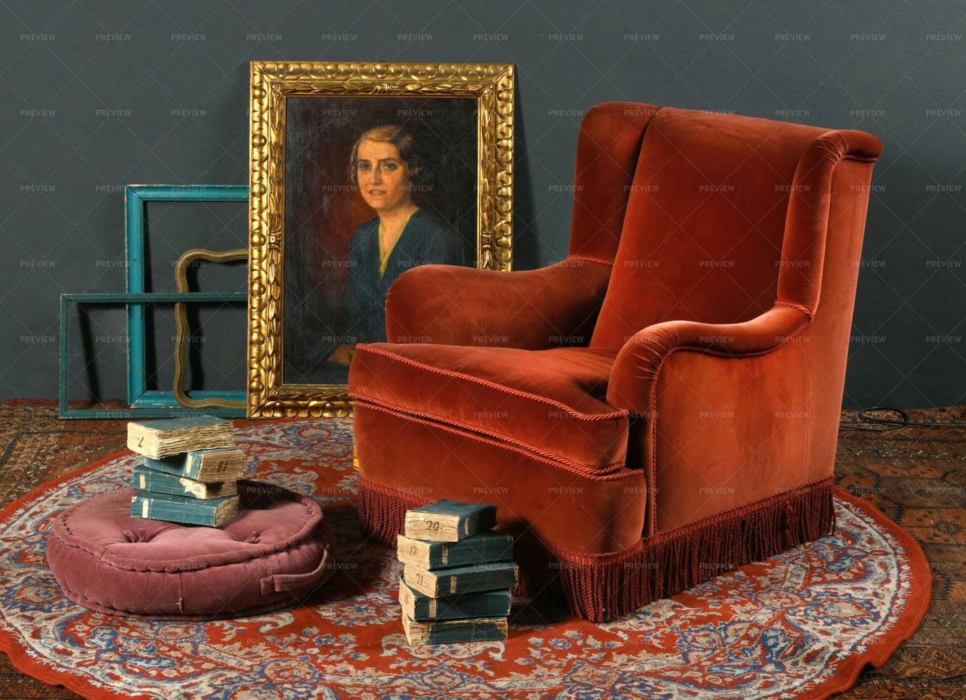 Retro Armchair Near Old Books: Stock Photos
