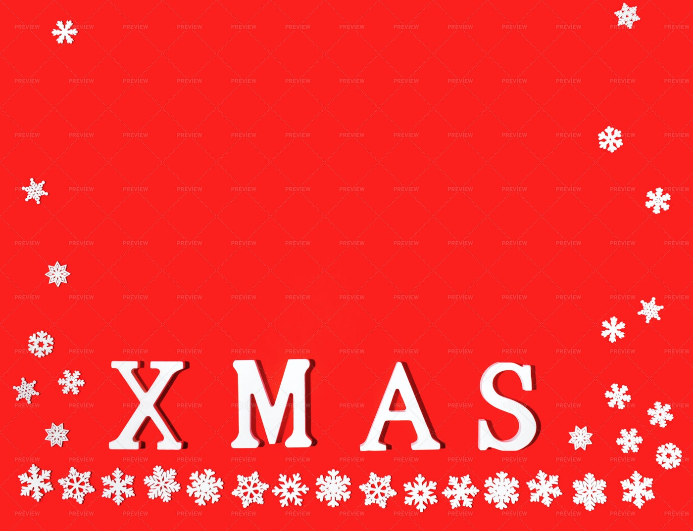 Snowflakes And Word XMAS On Red.: Stock Photos