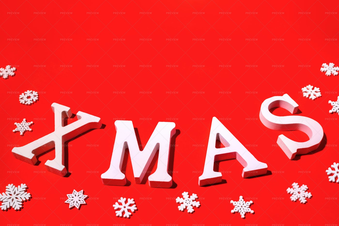 Christmas Red Backdrop With Word XMAS.: Stock Photos