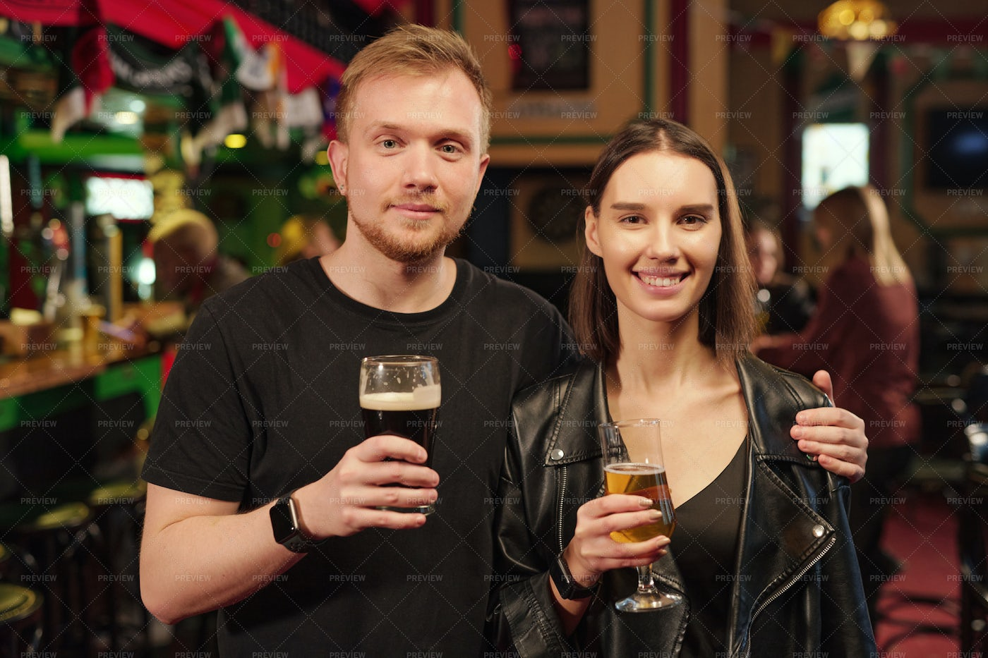 Young Couple Drinking Beer: Stock Photos