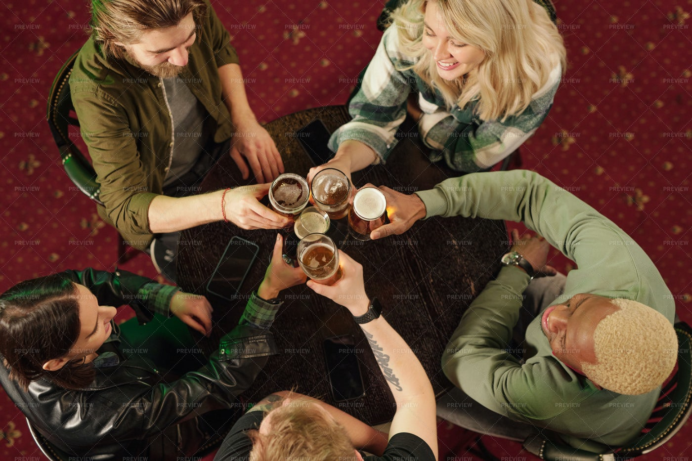 Friends Toasting With Beer In The Bar: Stock Photos