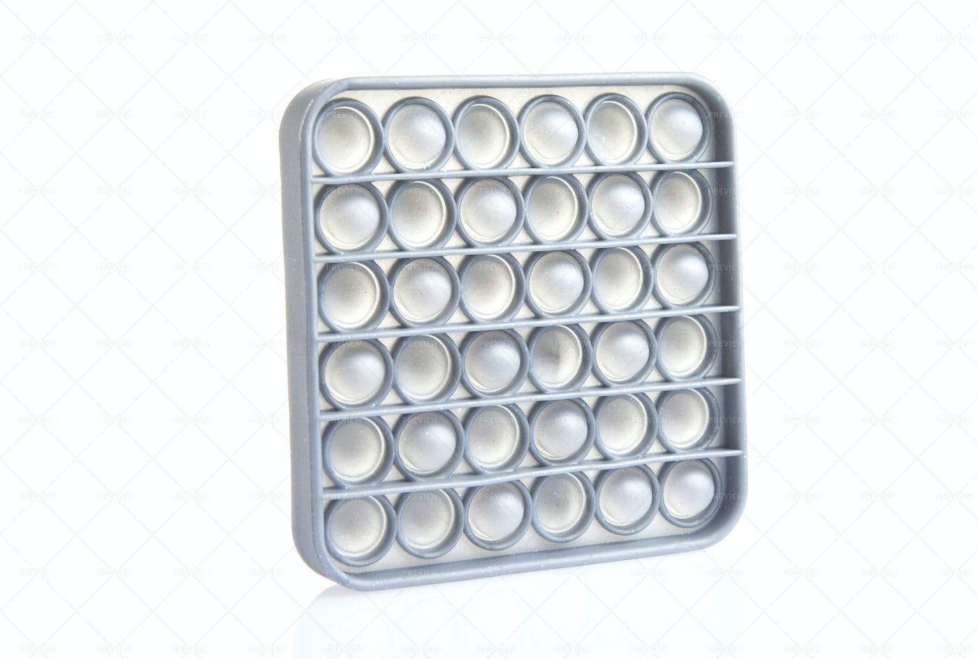 Grey Push Pop Toy: Stock Photos