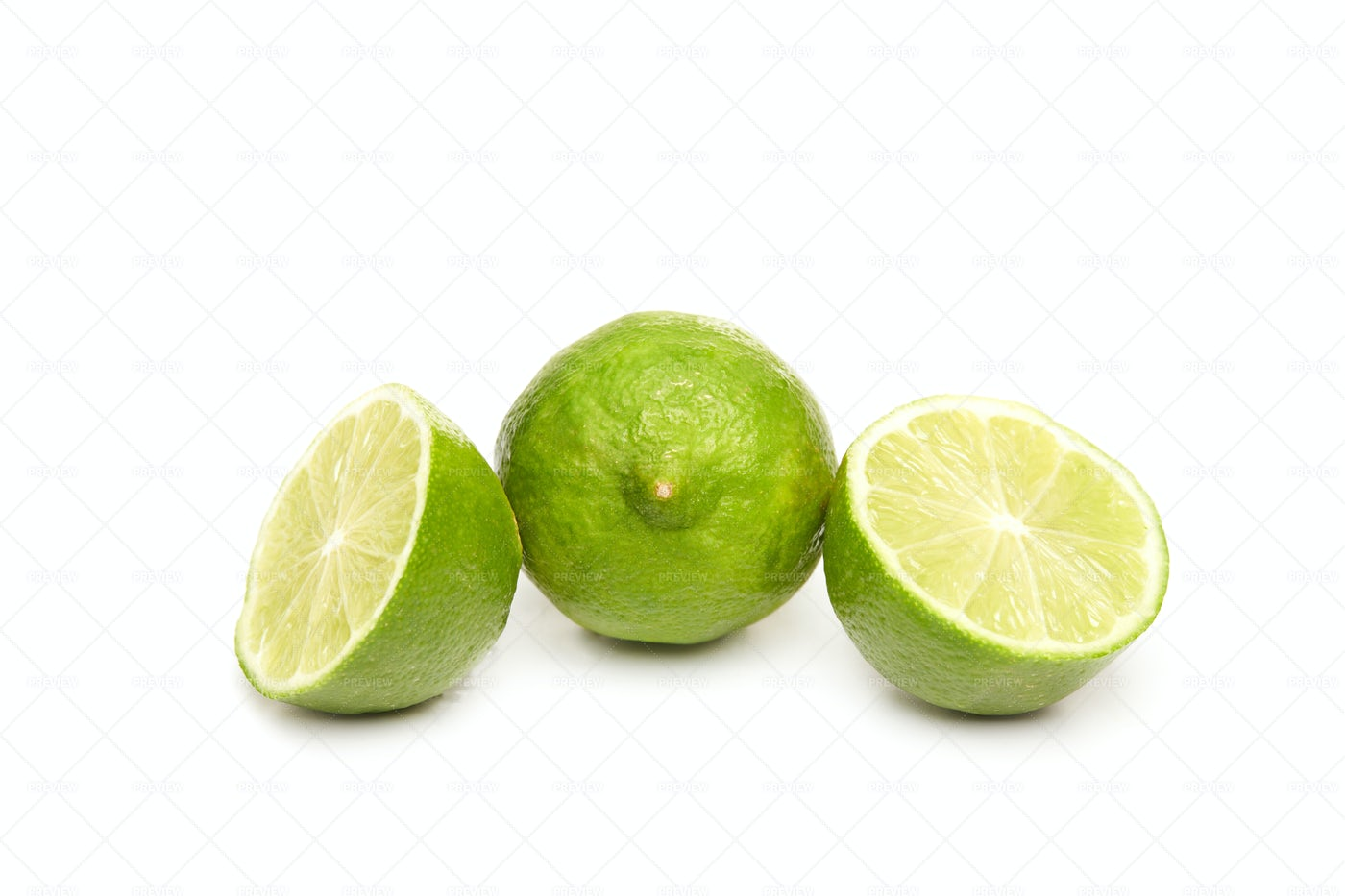 Fresh And Sliced Lime Isolated: Stock Photos