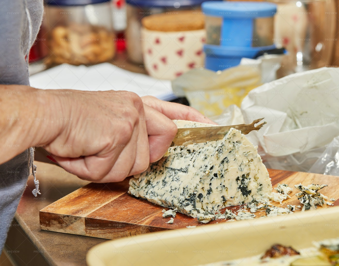 Woman Cuts Cheese With Knife: Stock Photos