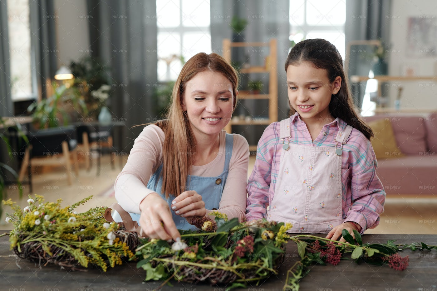Family Making Wreath From Flowers: Stock Photos