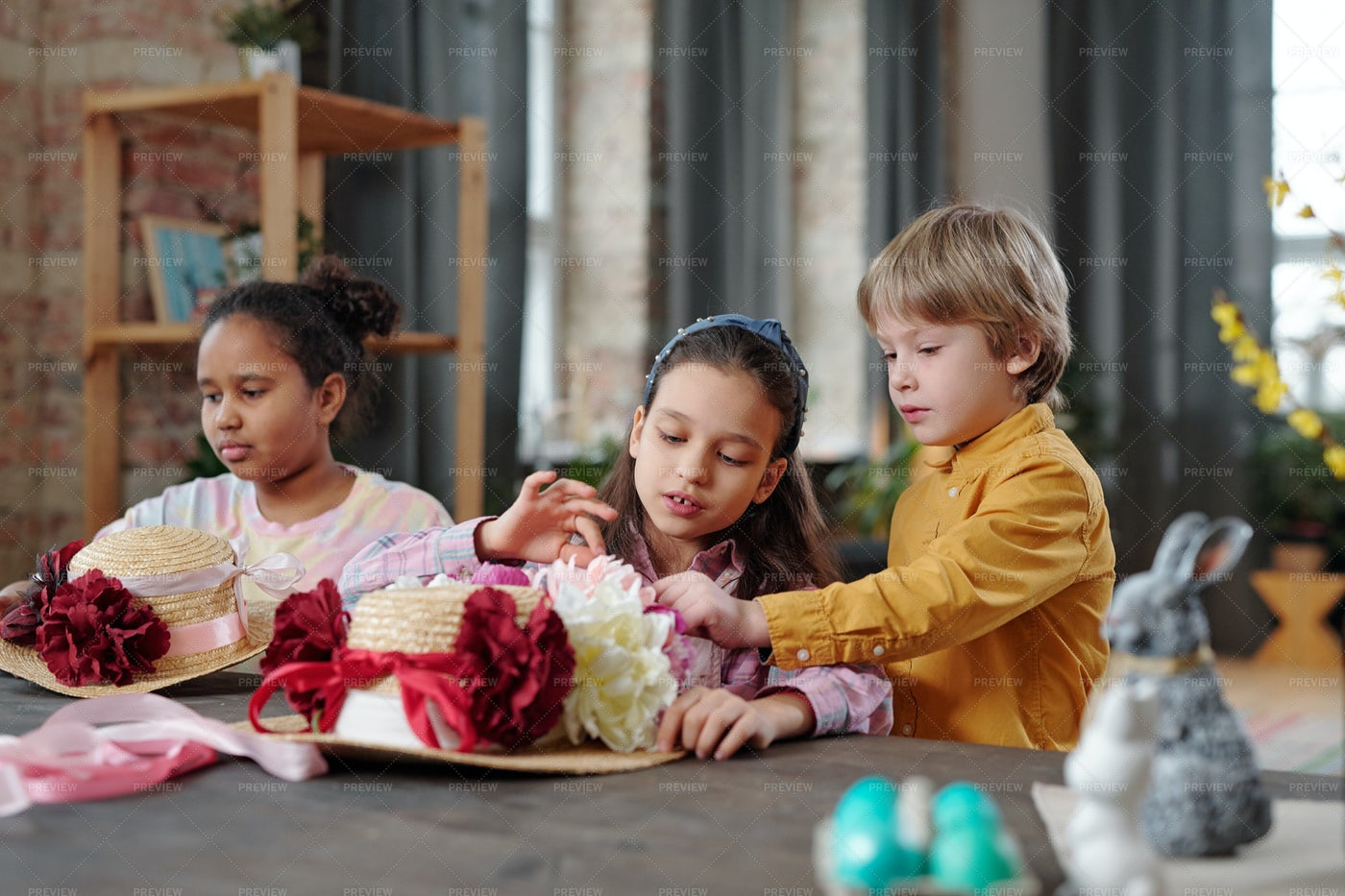 Children Decorating Hats With Flowers: Stock Photos