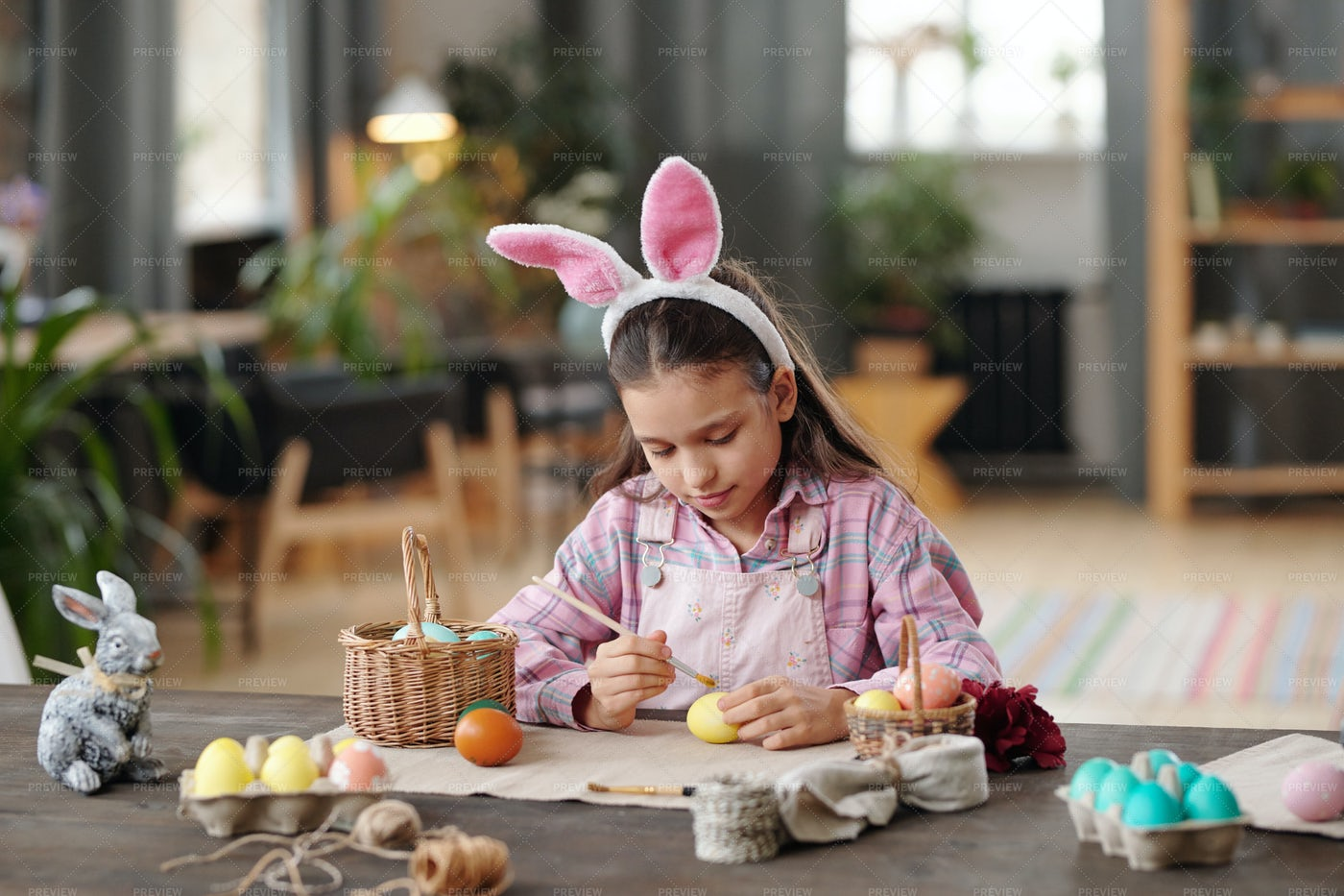 Little Girl Painting Easter Eggs: Stock Photos