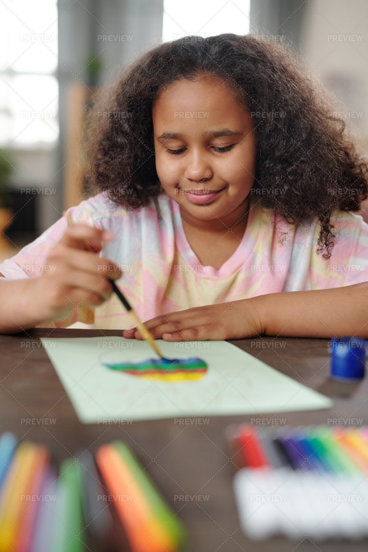 Little Girl Painting A Picture: Stock Photos
