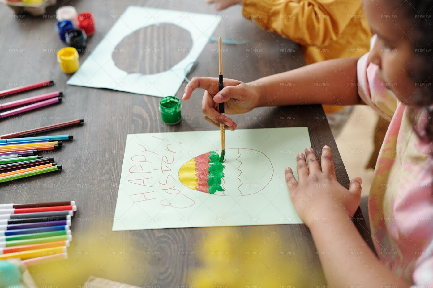 Child Painting A Greeting Card: Stock Photos