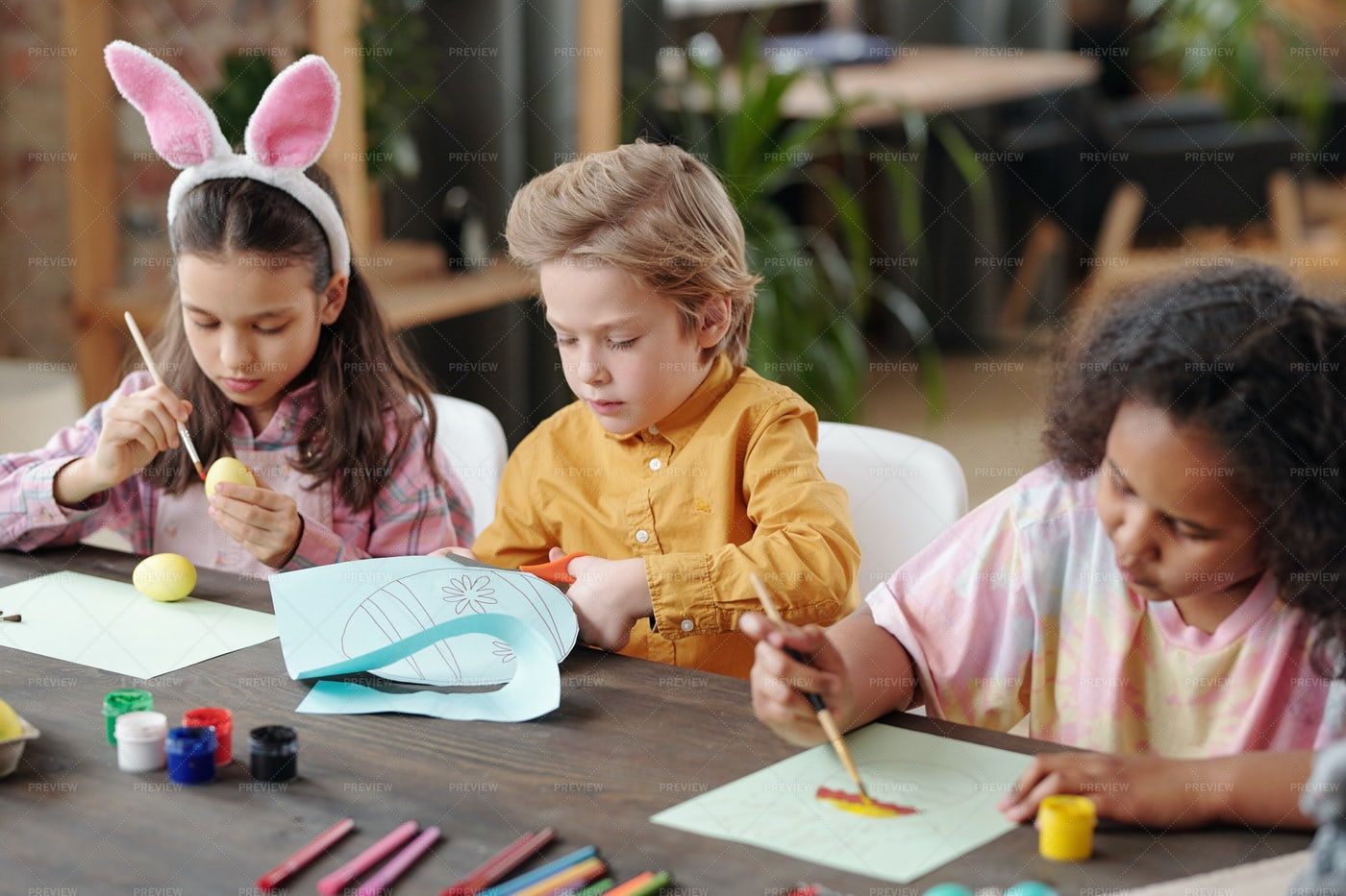 Children Painting At The Table: Stock Photos