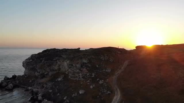 Sunrise Peeks Over The Cliff: Stock Video