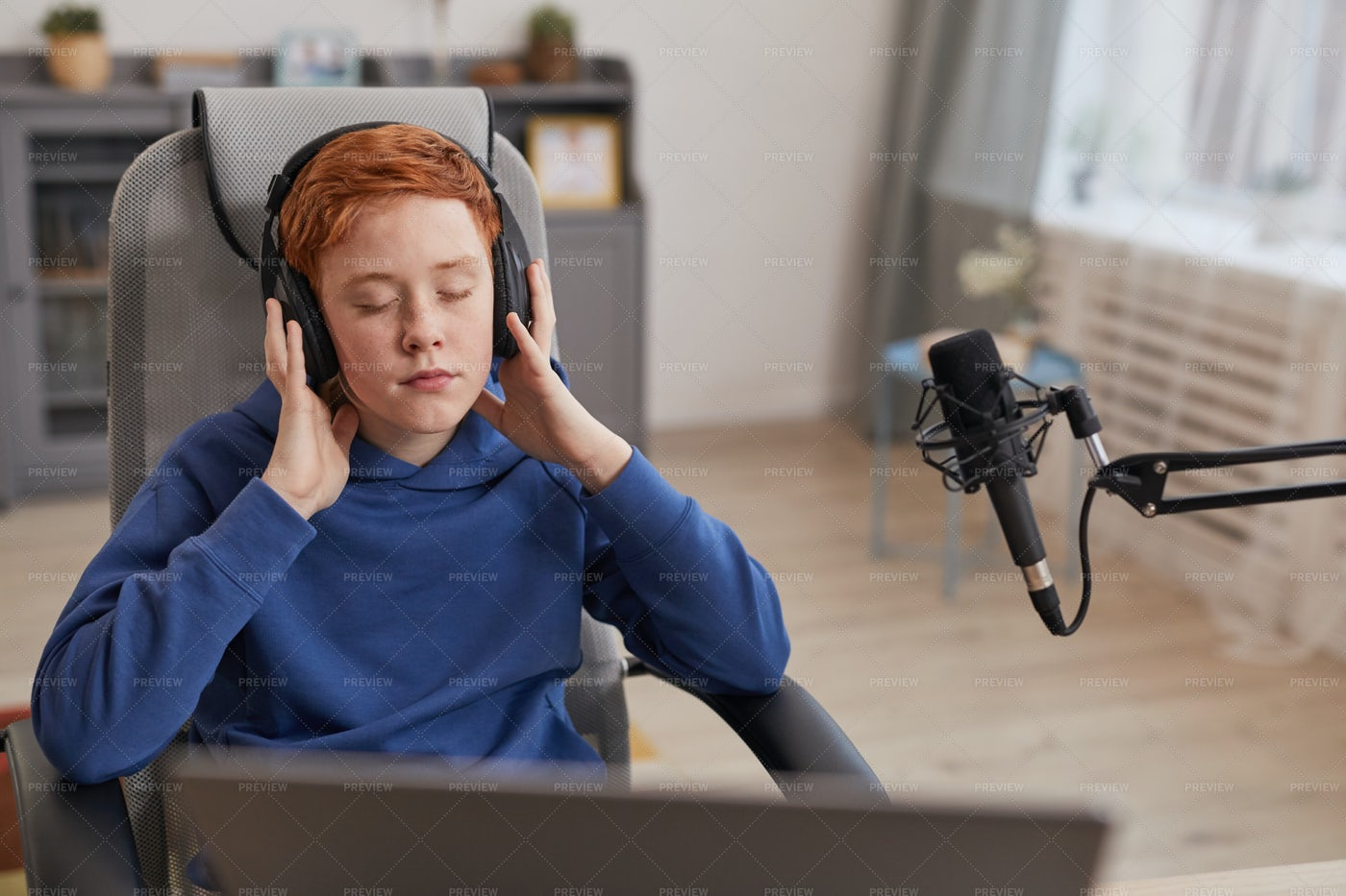 Boy Listening To Music In Headphones: Stock Photos