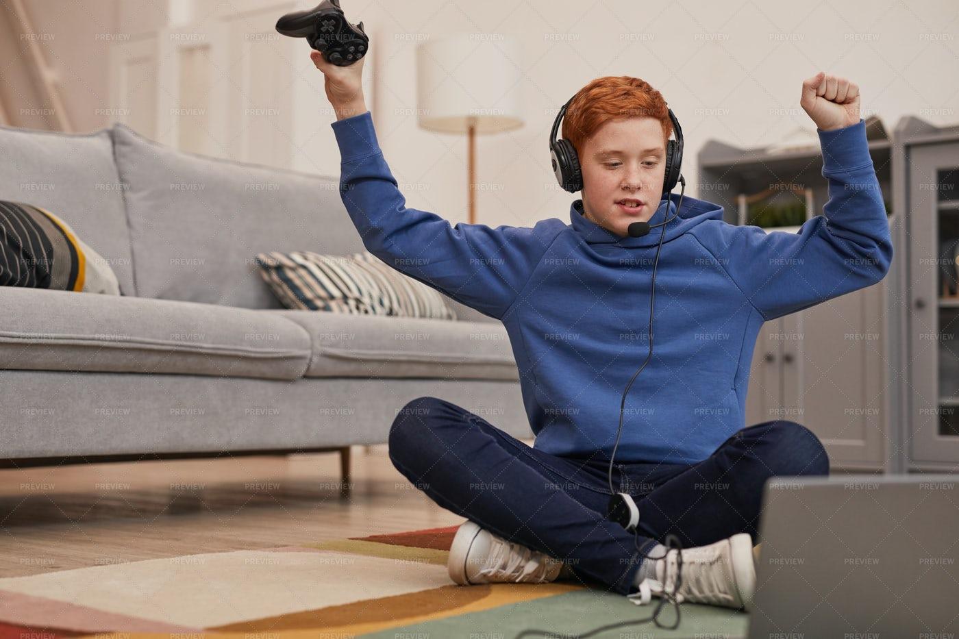 Joyful Boy Playing Video Games: Stock Photos