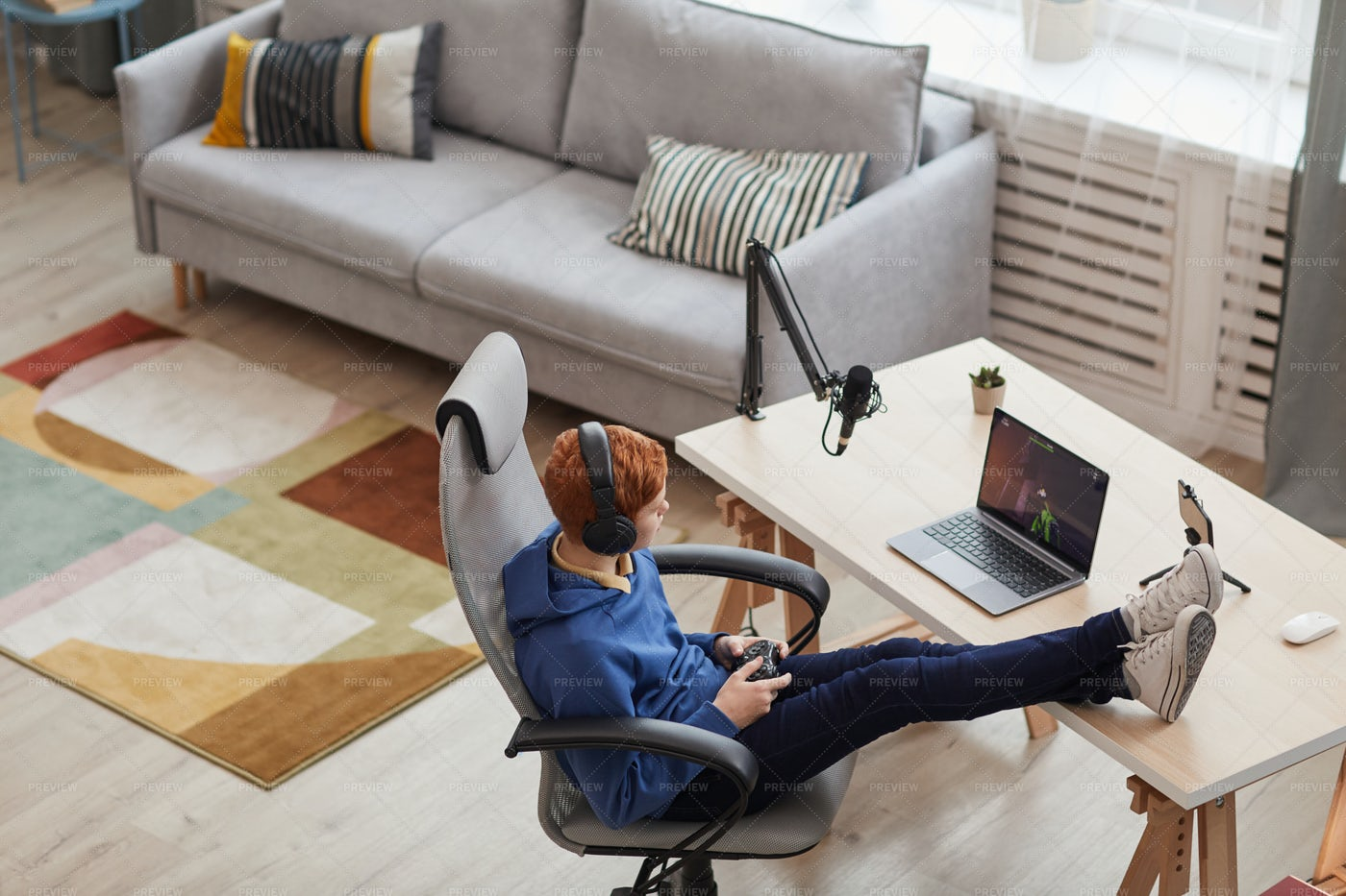 Relaxed Teenager Playing Video Games: Stock Photos