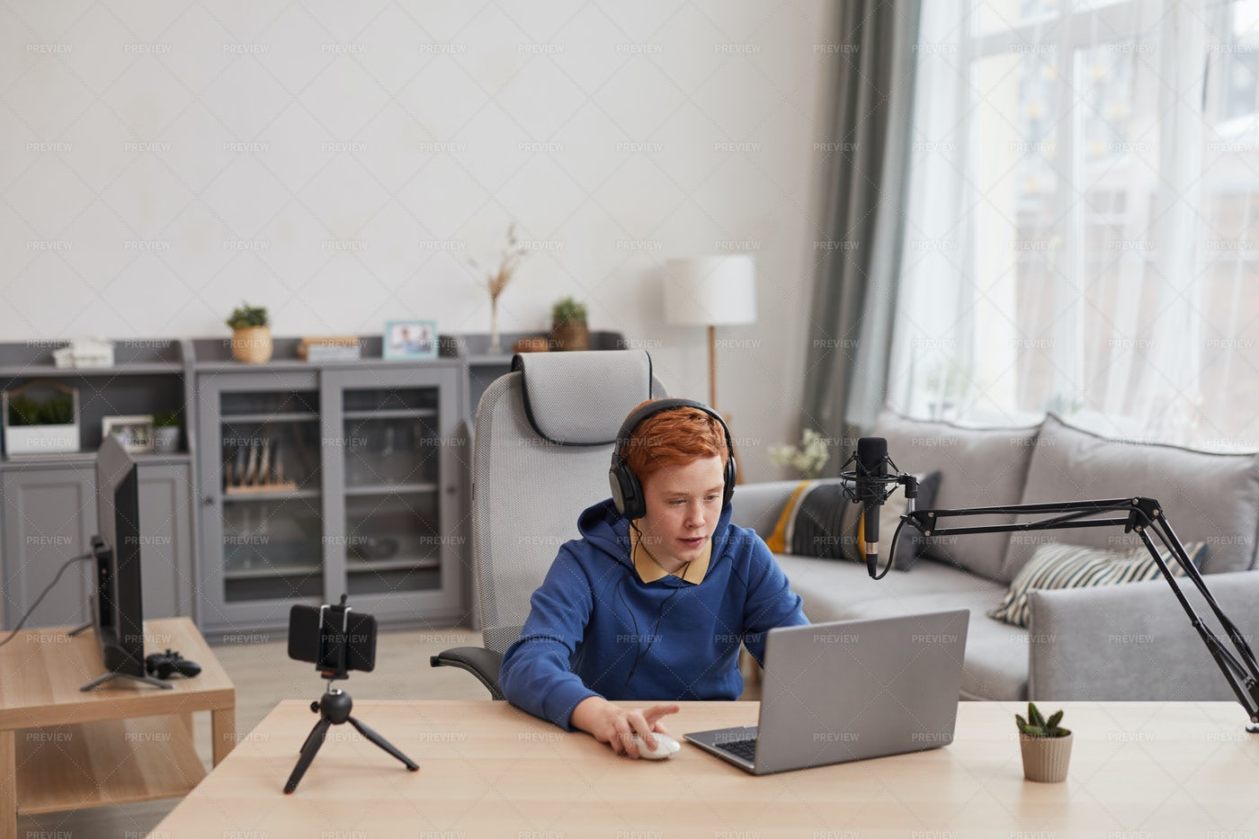 Streaming While Playing Video Games: Stock Photos
