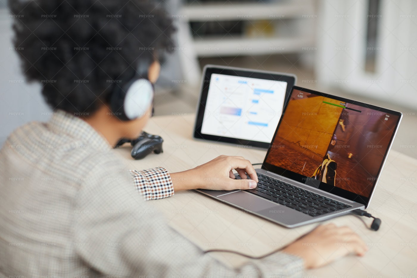 Boy Playing Video Games Online: Stock Photos
