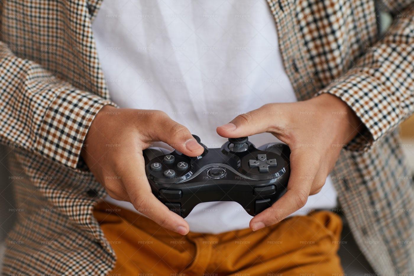 Hands Holding Gamepad: Stock Photos