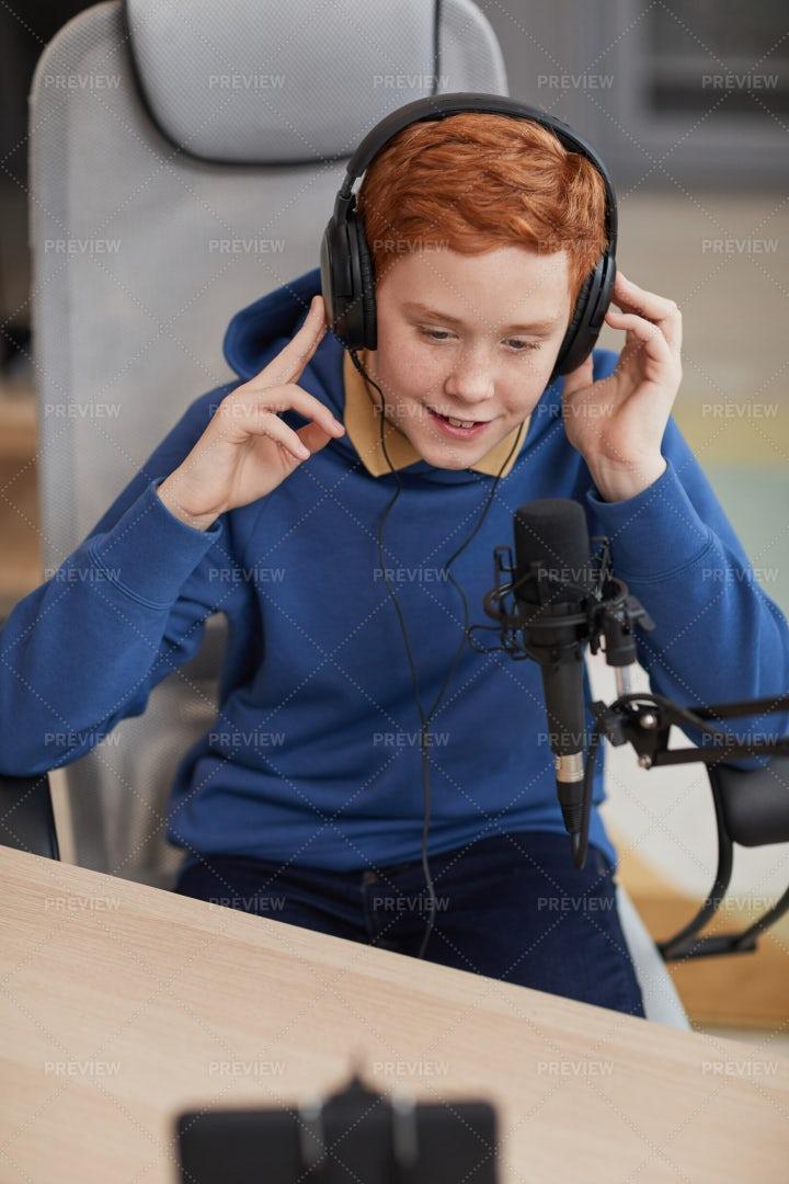 Teenage Boy Recording Blog: Stock Photos