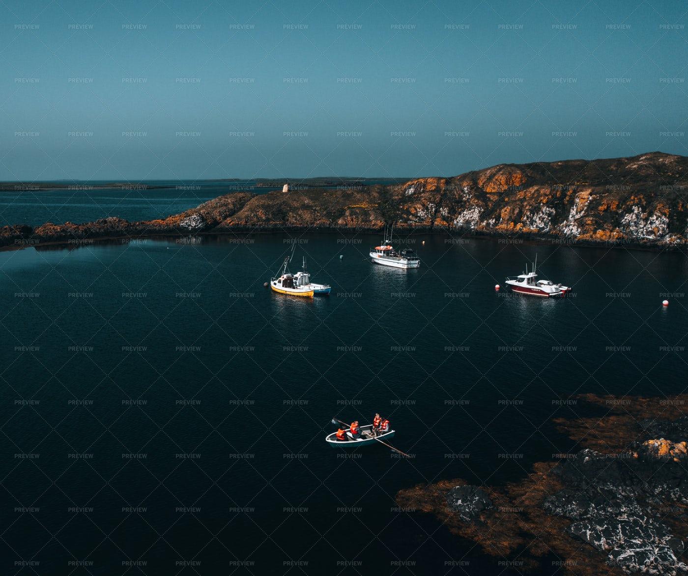 Boats In A Small Rocky Harbor: Stock Photos