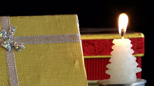 Gift Box And Tree Candle: Stock Video