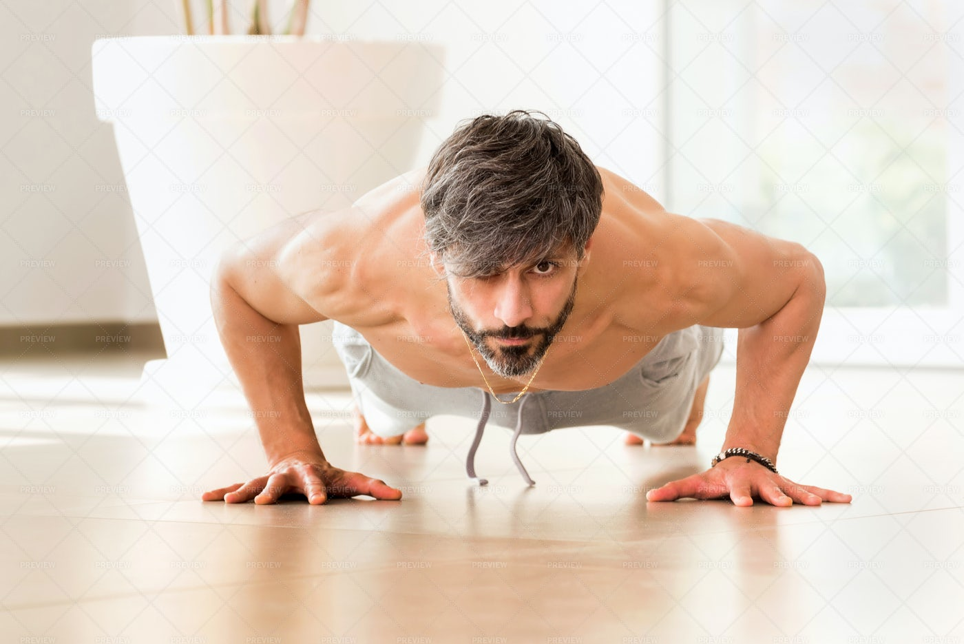Man Exercising On Plank: Stock Photos