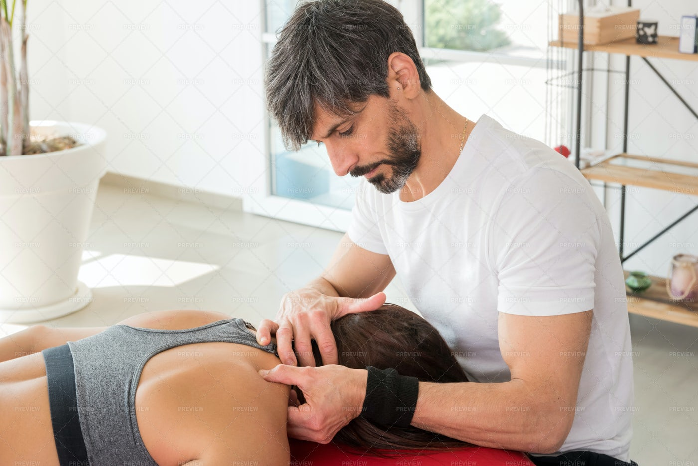 Performing Trigger Point Treatment: Stock Photos