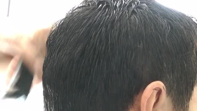 Barber Shaving Man's Hair: Stock Video