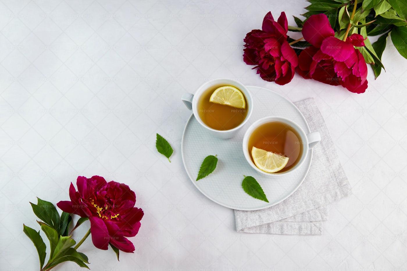 Cups Of Tea And Peonies: Stock Photos
