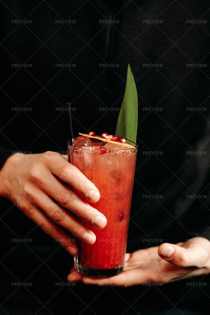 Bartender Holding A Cocktail: Stock Photos