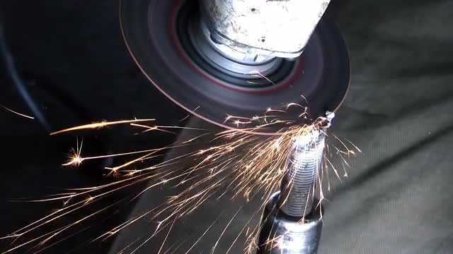 Angle Grinder Cutting Metal Screw: Stock Video