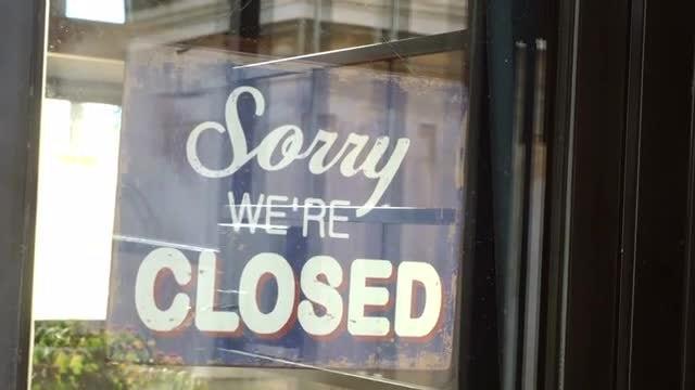 Shop Owner Changing Door Sign: Stock Video