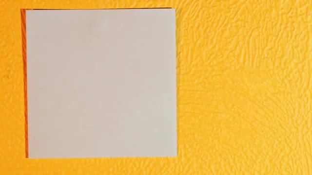 Posting Sticky Paper On Wall : Stock Video