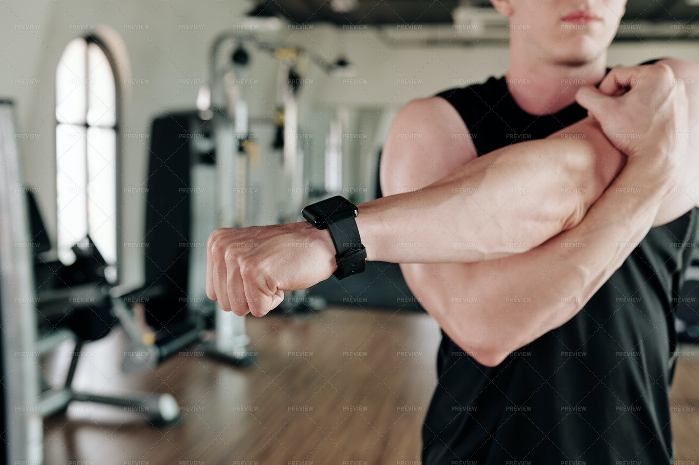 Sportsman Stretching Arms: Stock Photos