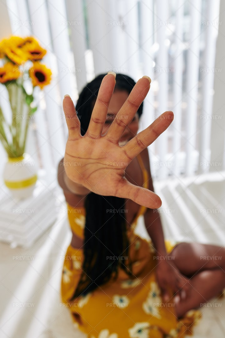 Woman Covering Camera With Hand: Stock Photos