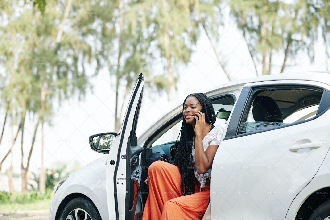 Woman Getting Out Of Car: Stock Photos