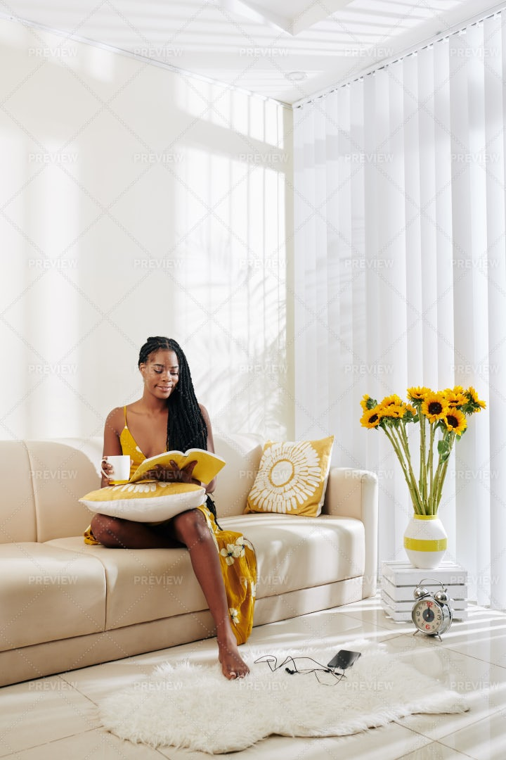 Young Woman Reading At Home: Stock Photos