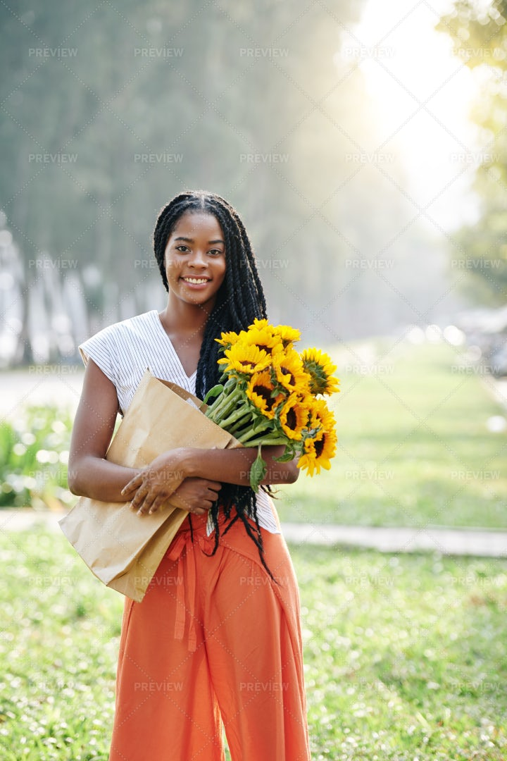 Happy Woman With Sunflowers: Stock Photos