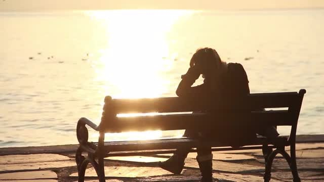 Lonely Woman On Beach Bench: Stock Video