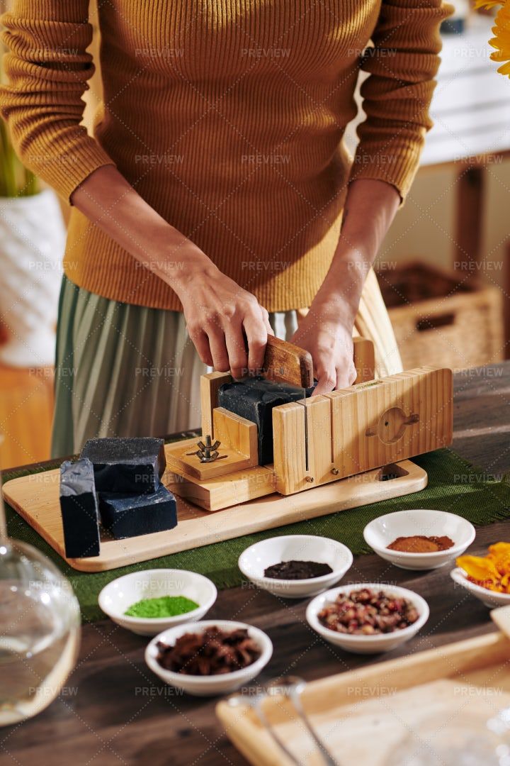 Woman Cutting Loaf Of Black Soap: Stock Photos