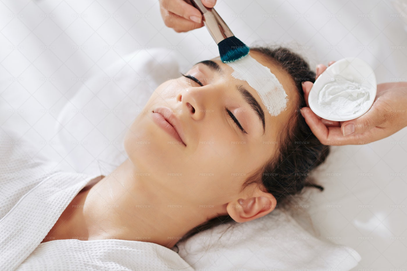 Woman Getting Moisturizing Mask: Stock Photos