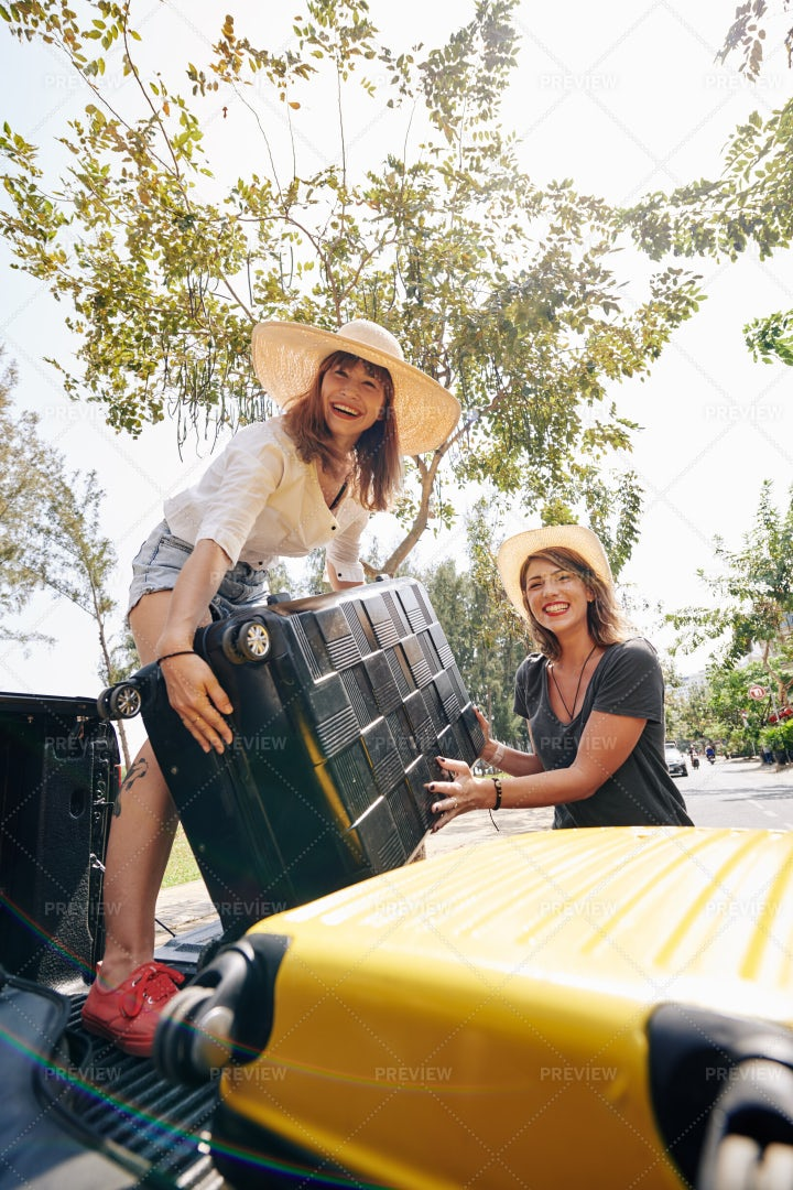 Travelers Putting Suitcases In Car: Stock Photos