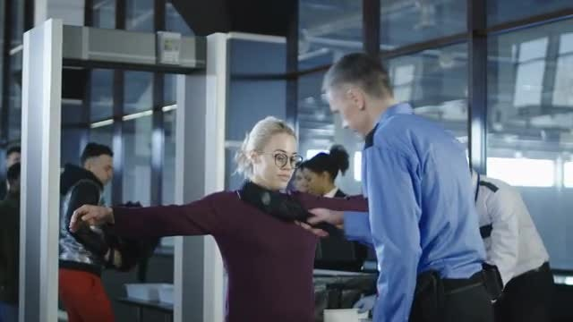 Airport Security Guard Checking Passenger: Stock Video