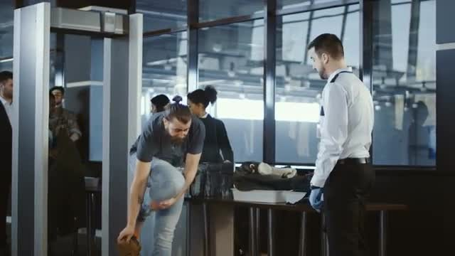 Airport Security Agent Frisking passenger: Stock Video