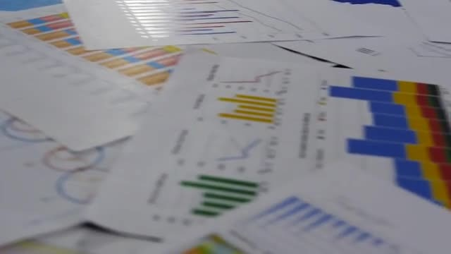 Panning Shot Of Business Charts: Stock Video