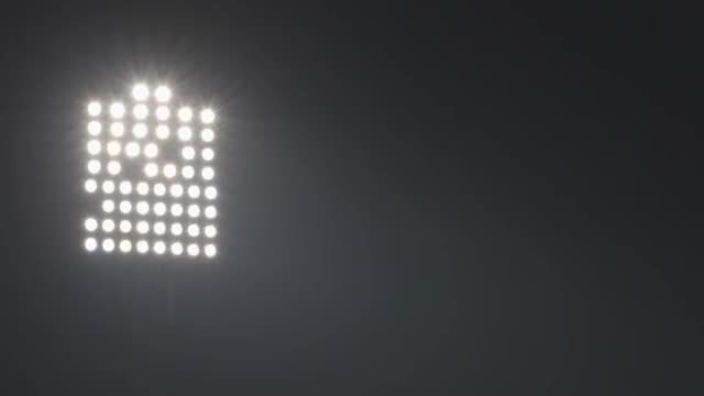 Stadium floodlights Shining Bright: Stock Video