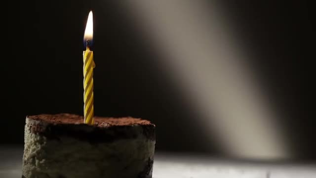 Burning Candle On Tiramisu Cake: Stock Video