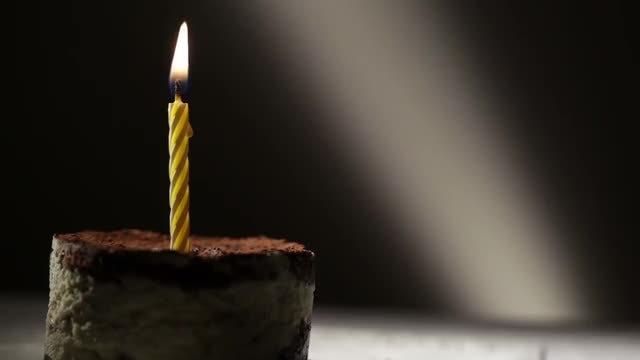 Burning Candle On Tiramisu Cake: Stock Video