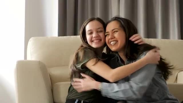 Sisters Embracing Each Other: Stock Video