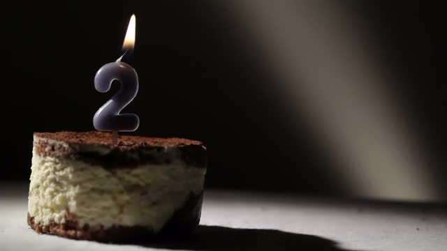 Number 2 Candle In Cake: Stock Video