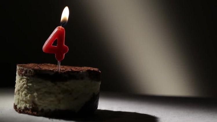 Candle Four in Tiramisu Cake: Stock Video